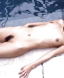 Skinny girl posing wet